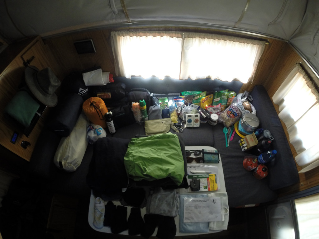 Everything we needed for a few days in the backcountry spread out in the camper